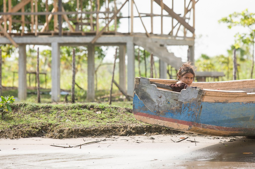 Young girl relaxes in riverside boat, La Mosquitia, Kruta community, Honduras - If Not Us Then Who?